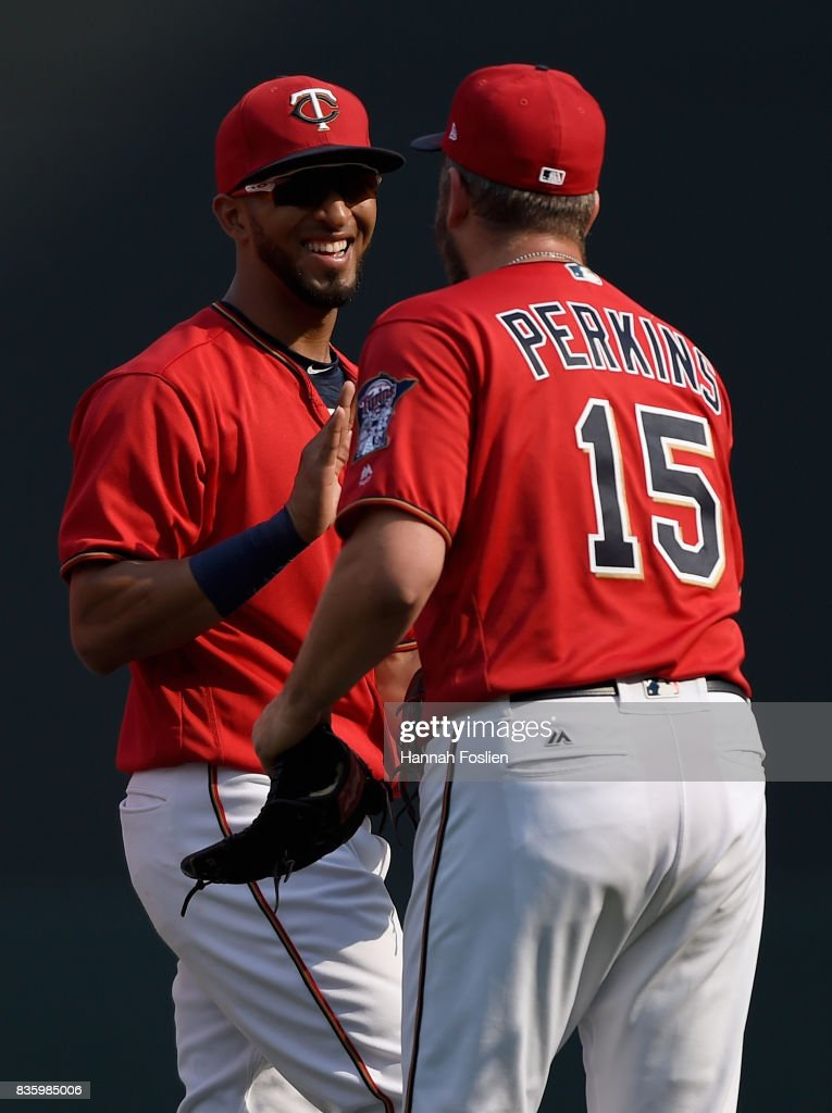 Eddie Rosario #20 and Glen Perkins #15 of the Minnesota Twins celebrate winning against the Arizona Diamondbacks after the game on August 20, 2017 at Target Field in Minneapolis, Minnesota. The Twins defeated the Diamondbacks 12-5.