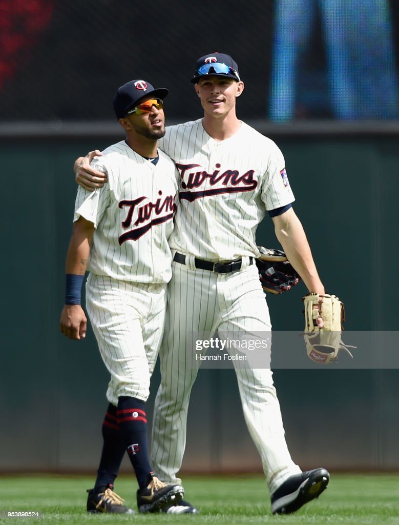 Eddie Rosario #20 and Max Kepler #26 of the Minnesota Twins walk off the field after defeating the Toronto Blue Jays in the game on May 2, 2018 at Target Field in Minneapolis, Minnesota. The Twins defeated the Blue Jays 4-0.