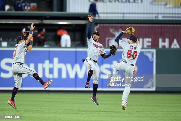 Eddie Rosario, Byron Buxton, and Jake Cave of the Minnesota Twins celebrates a win after during game one of a doubleheader baseball game against the...
