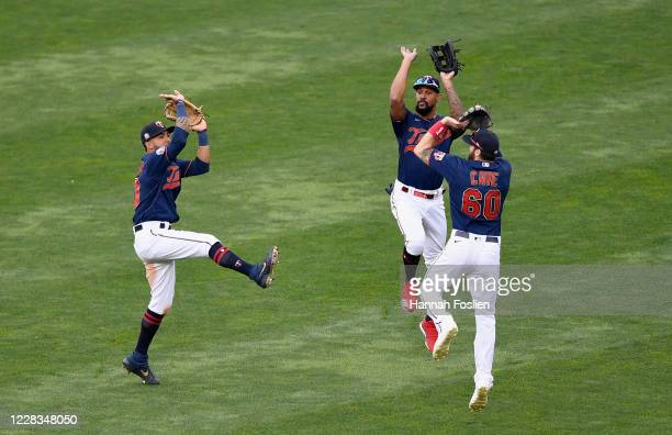 Eddie Rosario, Byron Buxton and Jake Cave of the Minnesota Twins celebrate defeating the Detroit Tigers in game two of a doubleheader at Target Field...
