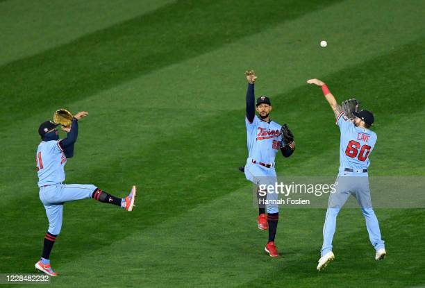 Eddie Rosario Byron Buxton and Jake Cave of the Minnesota Twins celebrate defeating the Cleveland Indians in the game at Target Field on September 12...