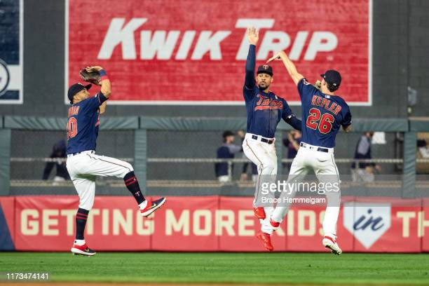 Eddie Rosario, Byron Buxton and Max Kepler celebrate against the Cleveland Indians on September 7, 2019 at the Target Field in Minneapolis,...