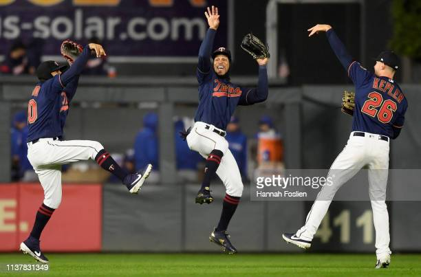 Eddie Rosario Byron Buxton and Max Kepler of the Minnesota Twins celebrate defeating the Toronto Blue Jays after the game on April 17 2019 at Target...