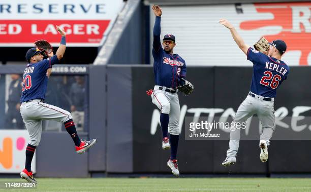 Eddie Rosario Byron Buxton and Max Kepler of the Minnesota Twins celebrate after defeating the New York Yankees at Yankee Stadium on May 04 2019 in...