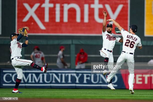 Eddie Rosario, Byron Buxton and Max Kepler of the Minnesota Twins celebrate against the St. Louis Cardinals on July 28, 2020 at the Target Field in...