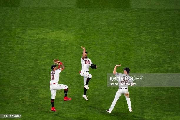 Eddie Rosario, Byron Buxton and Max Kepler of the Minnesota Twins celebrate against the Kansas City Royals on August 17, 2020 at Target Field in...