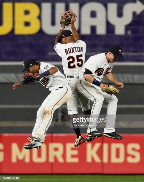 Eddie Rosario Byron Buxton and Max Kepler of the Minnesota Twins celebrate winning the game against the Chicago White Sox on June 20 2017 at Target...