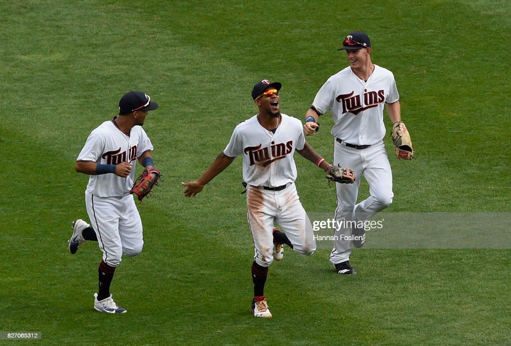 Eddie Rosario #20, Byron Buxton #25 and Max Kepler #26 of the Minnesota Twins celebrating winning against the Texas Rangers after the game on August 6, 2017 at Target Field in Minneapolis, Minnesota. The Twins defeated the Rangers 6-5.