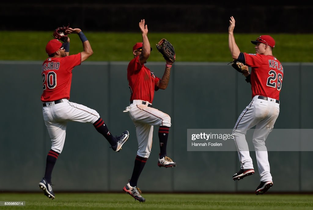 Eddie Rosario #20, Byron Buxton #25 and Max Kepler #26 of the Minnesota Twins celebrate winning against the Arizona Diamondbacks after the game on August 20, 2017 at Target Field in Minneapolis, Minnesota. The Twins defeated the Diamondbacks 12-5.