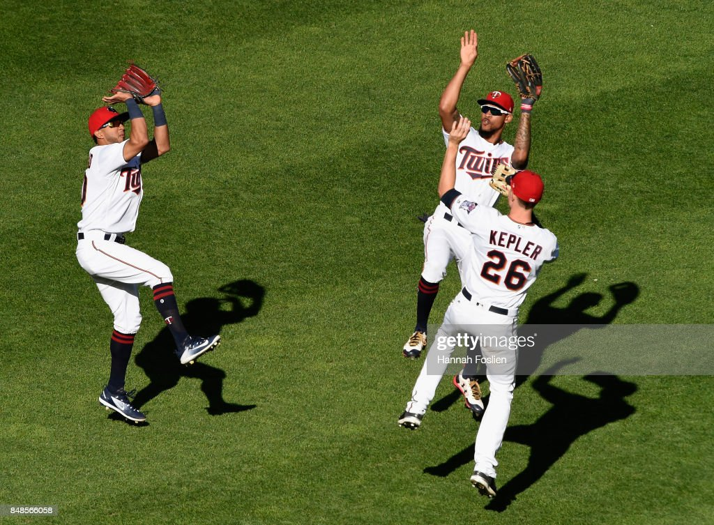 Eddie Rosario #20, Byron Buxton #25 and Max Kepler #26 of the Minnesota Twins celebrate winning against the Toronto Blue Jays after the game on September 17, 2017 at Target Field in Minneapolis, Minnesota. The Twins defeated the Blue Jays 13-7.