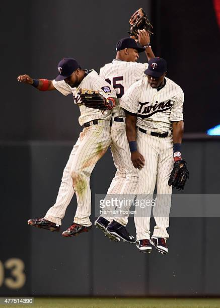 Eddie Rosario Byron Buxton and Torii Hunter of the Minnesota Twins celebrate a win of the game against the St Louis Cardinals on June 17 2015 at...