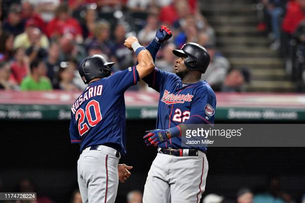 Eddie Rosario celebrates with Miguel Sano of the Minnesota Twins after both scored on a grand slam by Sano during the eighth inning of the second...