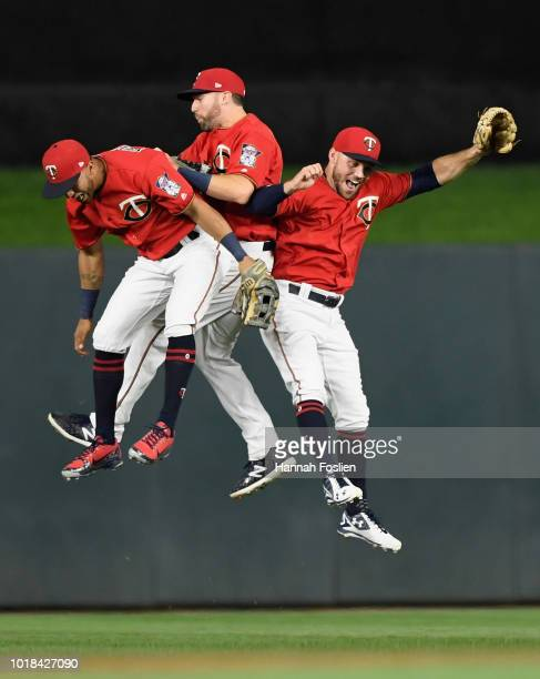 Eddie Rosario Jake Cave and Johnny Field of the Minnesota Twins celebrate defeating the Detroit Tigers after the game on August 17 2018 at Target...
