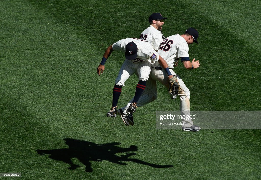 Eddie Rosario #20, Jake Cave #60 and Max Kepler #26 of the Minnesota Twins celebrate defeating the Baltimore Orioles after the game on July 7, 2018 at Target Field in Minneapolis, Minnesota. The Twins defeated the Orioles 5-4.