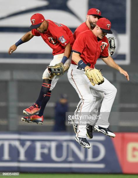 Eddie Rosario Jake Cave and Max Kepler of the Minnesota Twins celebrate defeating the Tampa Bay Rays after the game on July 13 2018 at Target Field...