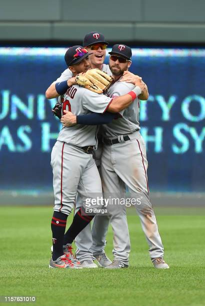 Eddie Rosario Max Kepler and Jake Cave of the Minnesota Twins celebrate a 53 win over the Kansas City Royals at Kauffman Stadium on June 22 2019 in...