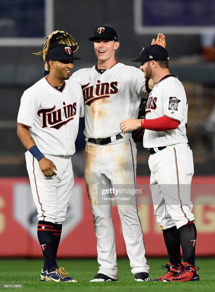 Eddie Rosario #20, Max Kepler #26 and Robbie Grossman #36 of the Minnesota Twins celebrate defeating the Tampa Bay Rays after the game on July 12, 2018 at Target Field in Minneapolis, Minnesota. The Twins defeated the Rays 5-1.