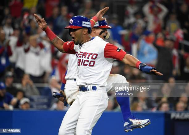 Eddie Rosario of Puerto Rico and Javier Baez celebrate after scoring during the sixth inning of the World Baseball Classic Pool F Game Four between...