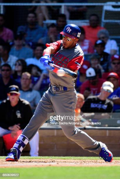 Eddie Rosario of Puerto Rico hits a double during an exhibition game against the Colorado Rockies on March 9 2017 in Scottsdale Arizona