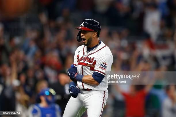 Eddie Rosario of the Atlanta Braves celebrates a three run home run during the fourth inning of Game Six of the National League Championship Series...