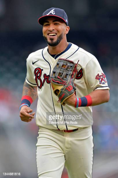Eddie Rosario of the Atlanta Braves returns to the dugout during a game against the New York Mets at Truist Park on October 3, 2021 in Atlanta,...