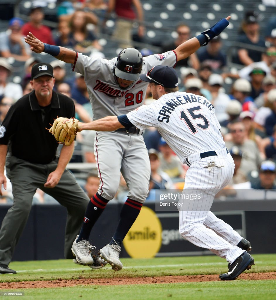 Eddie Rosario #20 of the Minnesota Twins avoids the tag of Cory Spangenberg #15 of the San Diego Padres as he's caught in a run down between third base and the plate during the sixth inning of a baseball game at PETCO Park on August 2, 2017 in San Diego, California. Rosario was called out for being outside the basepath.