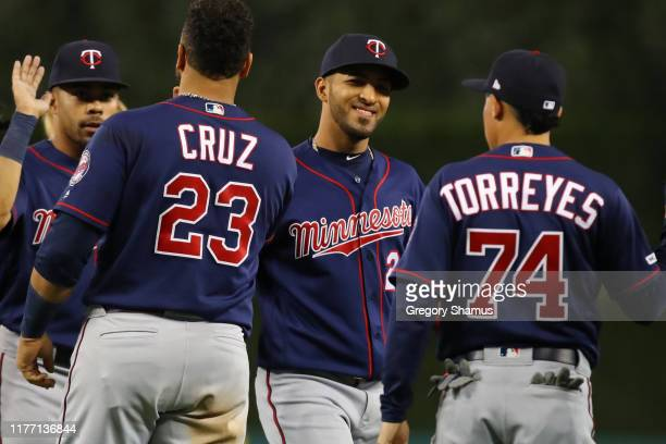 Eddie Rosario of the Minnesota Twins celebrates a 5-1 win over the Detroit Tigers with teammates at Comerica Park on September 25, 2019 in Detroit,...