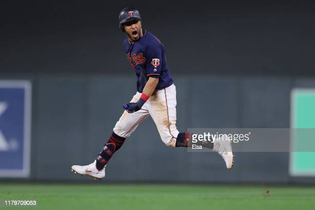 Eddie Rosario of the Minnesota Twins celebrates after his solo home run against the New York Yankees in the eighth inning in game three of the...