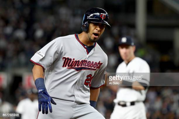 Eddie Rosario of the Minnesota Twins celebrates after hitting a two run home run against Luis Severino of the New York Yankees during the first...