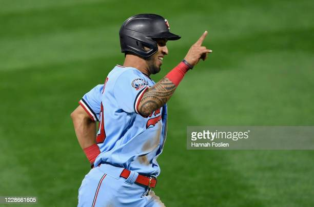 Eddie Rosario of the Minnesota Twins celebrates after scoring a walkoff run against the Detroit Tigers during the tenth inning of the game at Target...