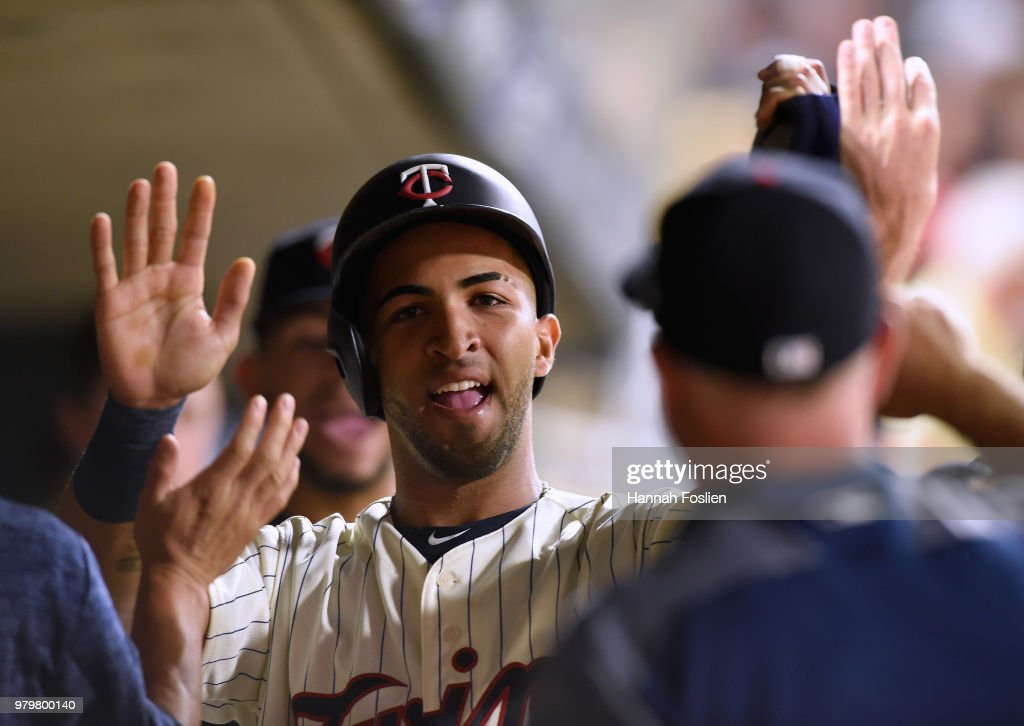 Eddie Rosario #20 of the Minnesota Twins celebrates scoring a run against the Boston Red Sox during the eighth inning of the game on June 20, 2018 at Target Field in Minneapolis, Minnesota. The Twins defeated the Red Sox 4-1.