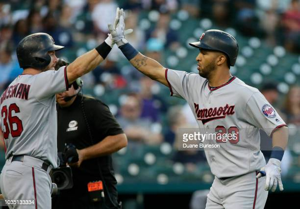 Eddie Rosario of the Minnesota Twins celebrates with Robbie Grossman of the Minnesota Twins after hitting a solo home run against the Detroit Tigers...