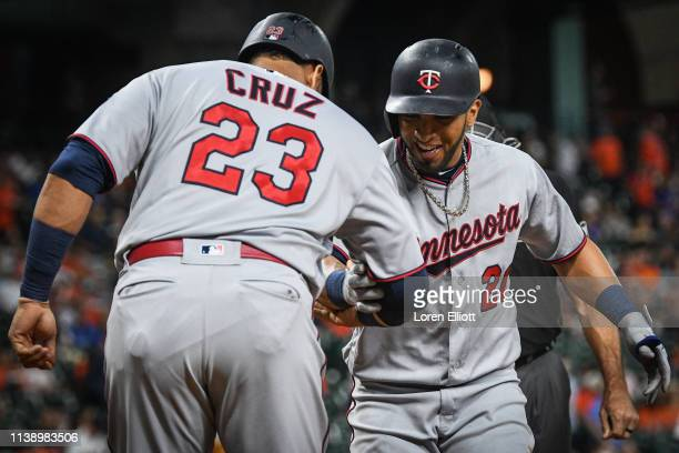 Eddie Rosario of the Minnesota Twins celebrates with teammate Nelson Cruz after hitting a three run home run during the first inning of the game...