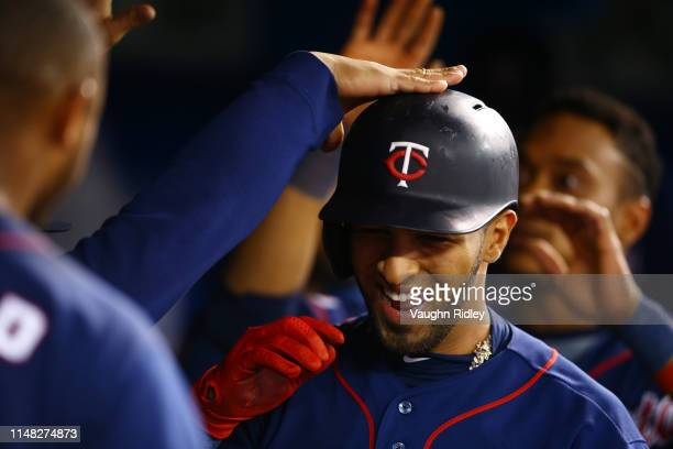 Eddie Rosario of the Minnesota Twins celebrates with teammates after hitting a 2 run home run in the sixth inning during a MLB game against the...