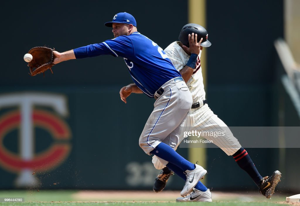 Eddie Rosario #20 of the Minnesota Twins gets back to first base safely as Lucas Duda #21 of the Kansas City Royals fields the throw during the sixth inning of the game on July 11, 2018 at Target Field in Minneapolis, Minnesota. The Twins defeated the Royals 8-5.