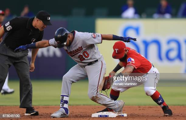 Eddie Rosario of the Minnesota Twins hits a double in front of Rougned Odor of the Texas Rangers in the second inning at Globe Life Park in Arlington...