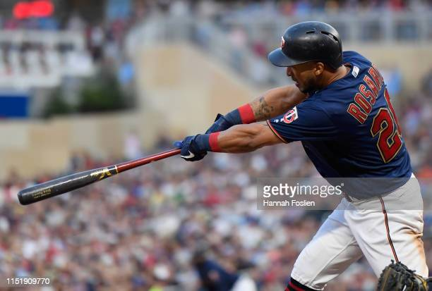 Eddie Rosario of the Minnesota Twins hits an RBI single against the Tampa Bay Rays during the fourth inning of the game on June 25 2019 at Target...