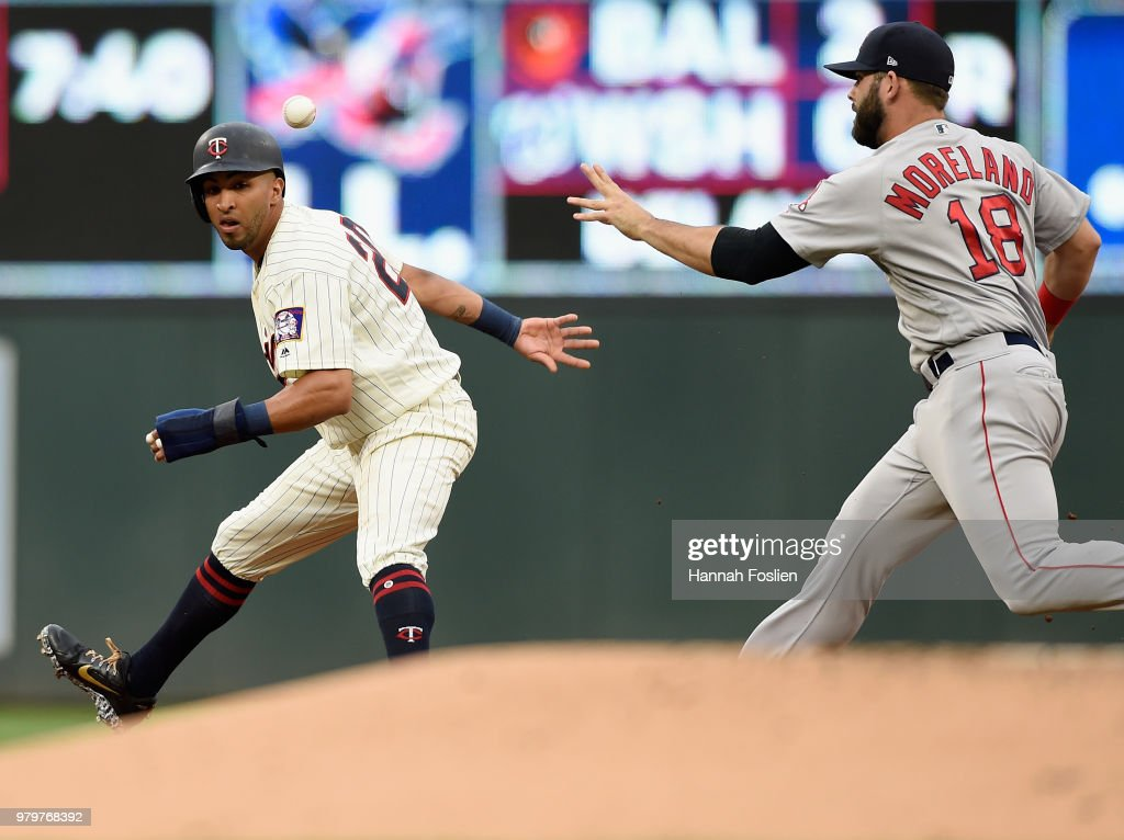 Eddie Rosario #20 of the Minnesota Twins is caught between first and second base as Mitch Moreland #18 of the Boston Red Sox passes the ball over Rosario during the first inning of the game on June 20, 2018 at Target Field in Minneapolis, Minnesota.