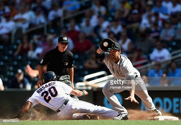 Eddie Rosario of the Minnesota Twins is caught off first base by Garrett Jones of the New York Yankees to end the game on July 26 2015 at Target...