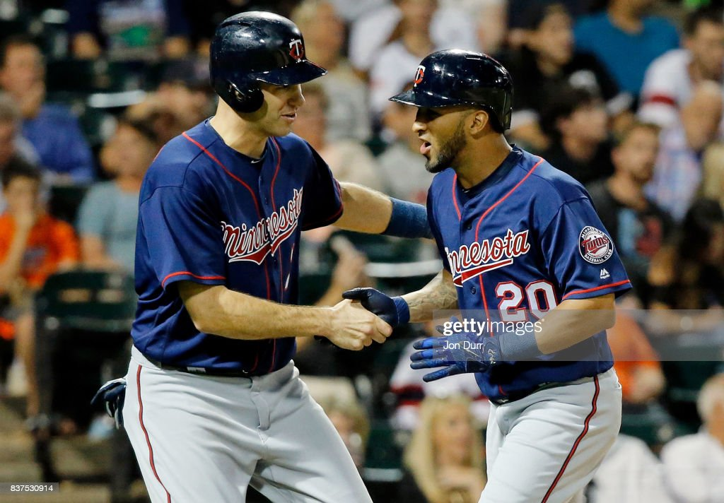 Eddie Rosario #20 of the Minnesota Twins (R) is congratulated by Joe Mauer #7 after hitting a two run home run against the Chicago White Sox during the sixth inning at Guaranteed Rate Field on August 22, 2017 in Chicago, Illinois.