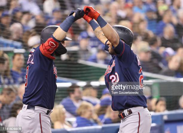 Eddie Rosario of the Minnesota Twins is congratulated by Marwin Gonzalez after hitting a solo home run in the fifth inning during MLB game action...