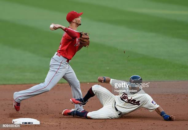 Eddie Rosario of the Minnesota Twins is out at second base as Andrelton Simmons of the Los Angeles Angels of Anaheim attempts to turns a double play...