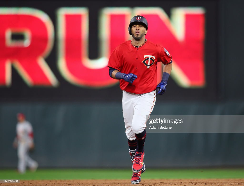 Eddie Rosario #20 of the Minnesota Twins rounds second base on his home run against the Cincinnati Reds in the ninth inning at Target Field on April 27, 2018 in Minneapolis, Minnesota. The Reds defeated the Twins 15-9.