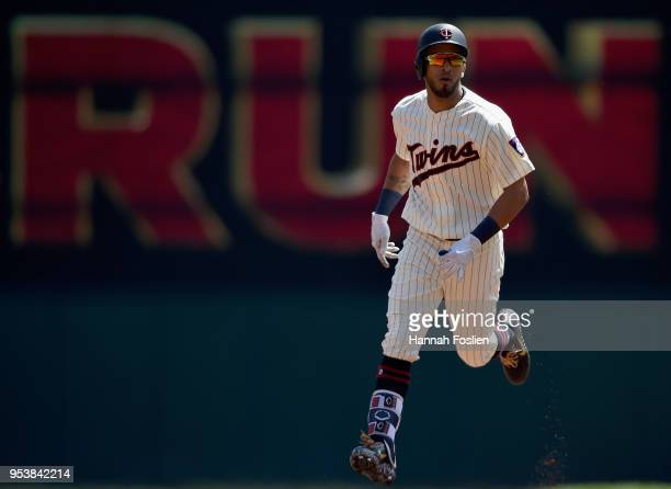 Eddie Rosario of the Minnesota Twins rounds the bases after hitting a solo home run against the Toronto Blue Jays during the second inning of the...