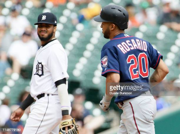 Eddie Rosario of the Minnesota Twins rounds the bases past third baseman Dawel Lugo of the Detroit Tigers after hitting a solo home run during the...