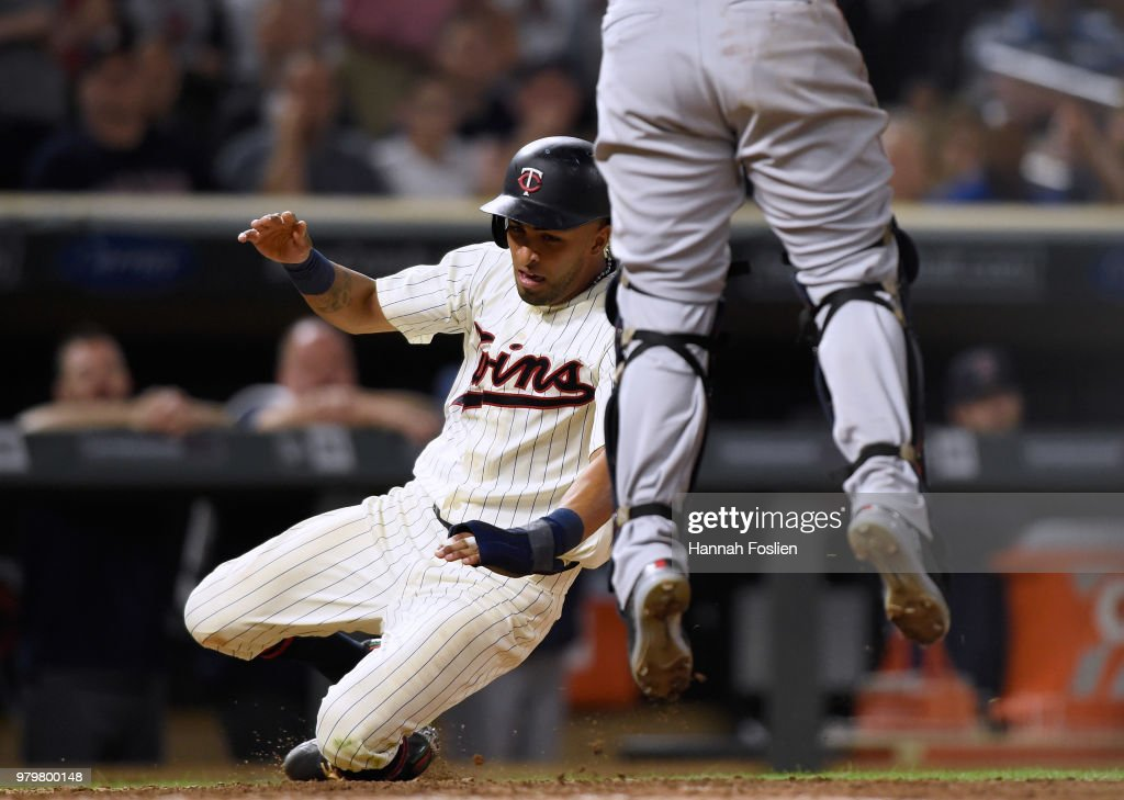 Eddie Rosario #20 of the Minnesota Twins slides safely into home plate as Christian Vazquez #7 of the Boston Red Sox jumps to catch the ball during the eighth inning of the game on June 20, 2018 at Target Field in Minneapolis, Minnesota. The Twins defeated the Red Sox 4-1.