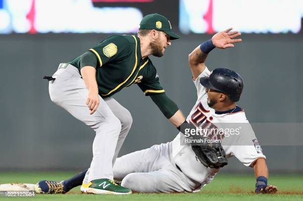 Eddie Rosario of the Minnesota Twins steals second base as Jed Lowrie of the Oakland Athletics applies the tag during the third inning of the game on...