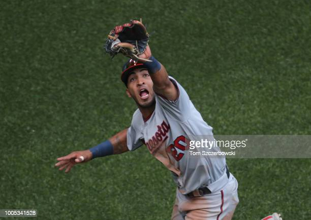Eddie Rosario of the Minnesota Twins stretches to make a running catch in the fifth inning during MLB game action against the Toronto Blue Jays at...