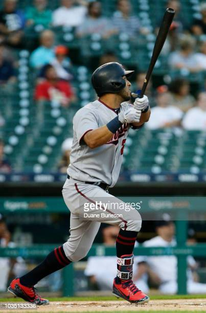 Eddie Rosario of the Minnesota Twins watches his solo home run hit off of Jordan Zimmermann of the Detroit Tigers during the first inning at Comerica...