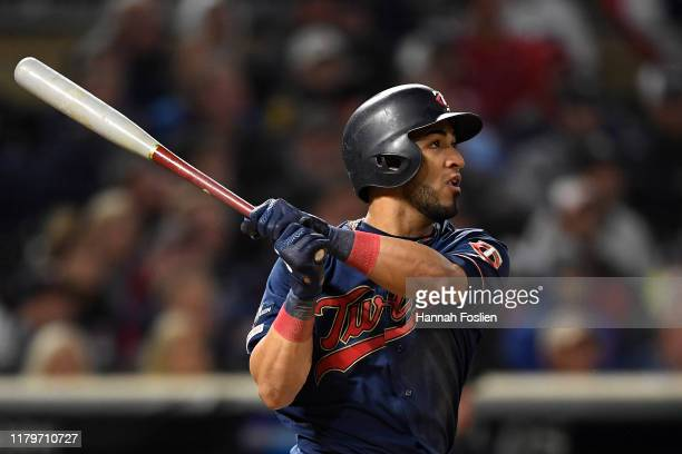 Eddie Rosario of the Minnesota Twins watches his solo home run against the New York Yankees in the eighth inning in game three of the American League...